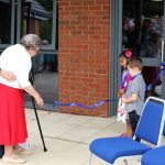 cutting the ribbon at the moulton community centre