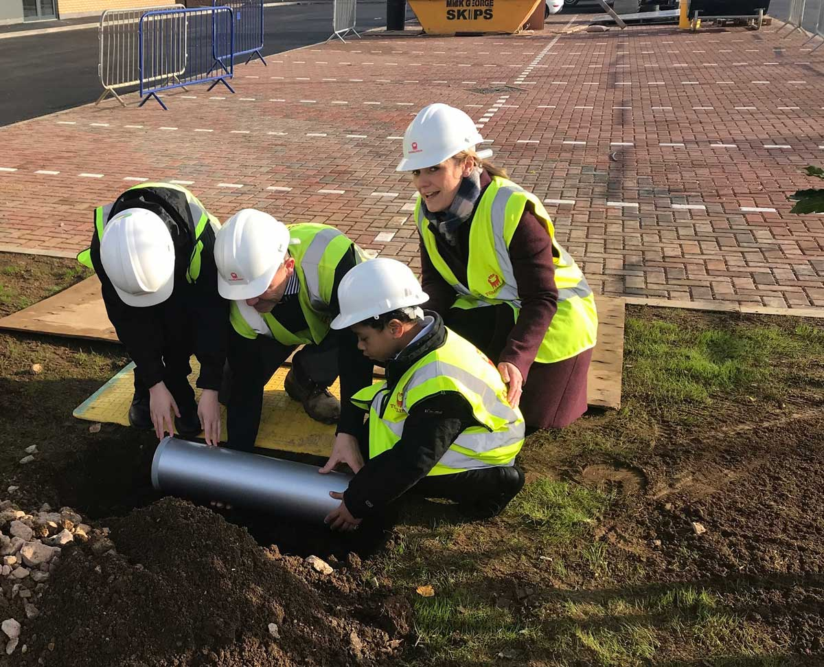pupils bury a time capsule on site