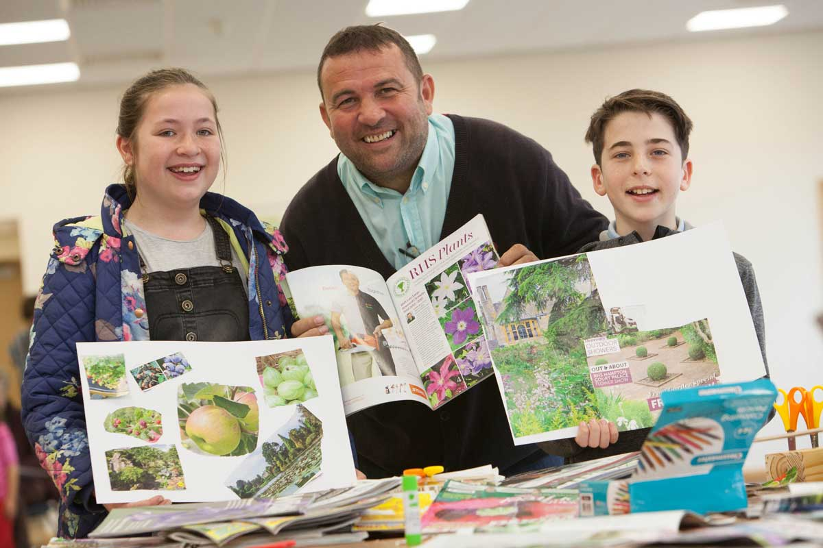 Chris Collins with youngsters preparing their garden design.