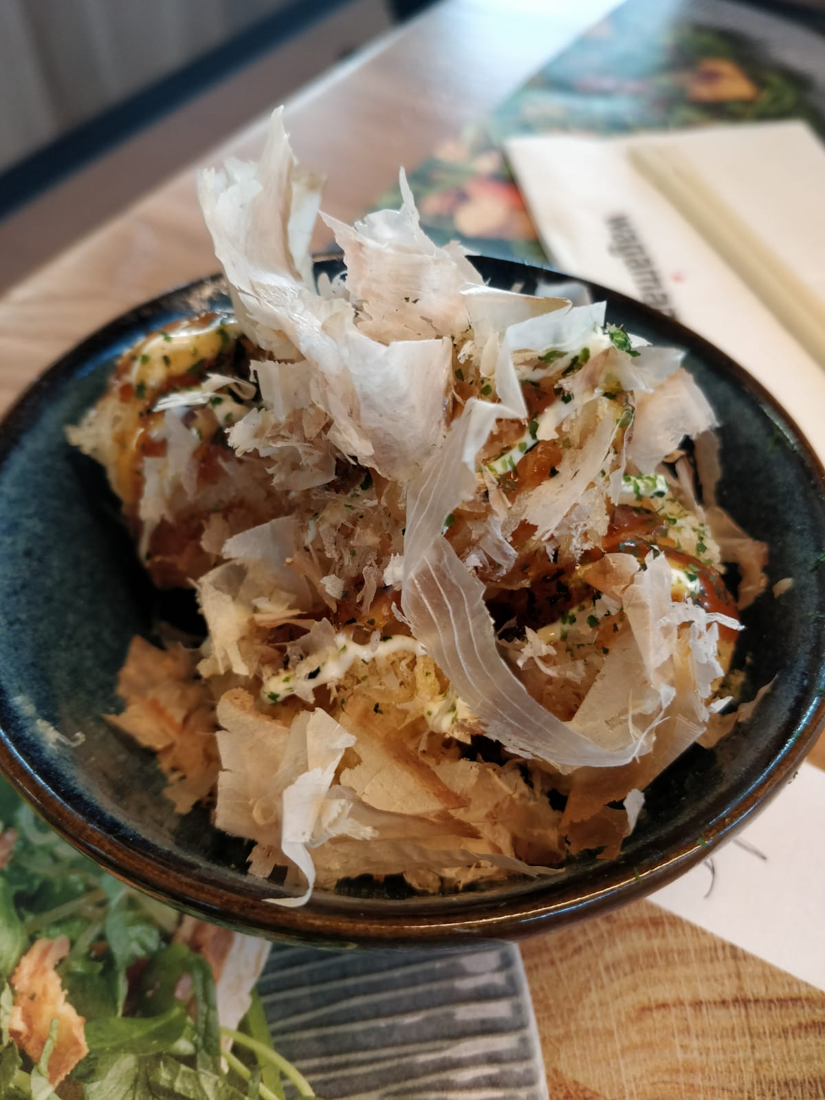 Tama Squid - crispy fried squid balls, drizzled with okonomiyaki sauce and mayonnaise. finished with aonori and bonito flakes
